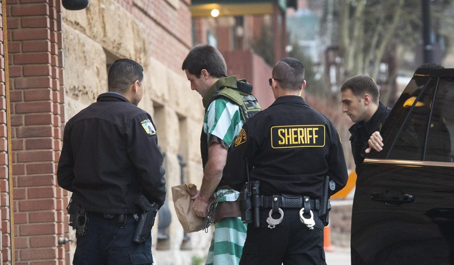 Teller County Sheriff deputies lead Patrick Frazee into the Teller County Courthouse on Friday, April 5, 2019, in Cripple Creek, Colo. Frazee, is charged with murdering 29-year-old Kelsey Berreth. He has not entered a plea yet. (Christian Murdock/The Gazette via AP)