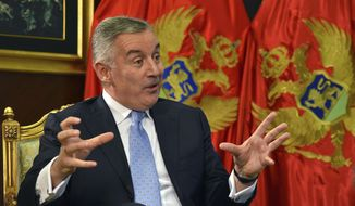 Montenegro President Milo Djukanovic speaks and gestures during an interview with The Associated Press in Montenegro's capital Podgorica, Thursday, April 4, 2019. The pro-Western president of Montenegro, who has defied Russia to steer his small country into NATO, has warned that the integration of Western Balkans into the EU is crucial for the bloc to protect itself from growing Russian and Chinese political and economic influence in the region. (AP Photo/Risto Bozovic)