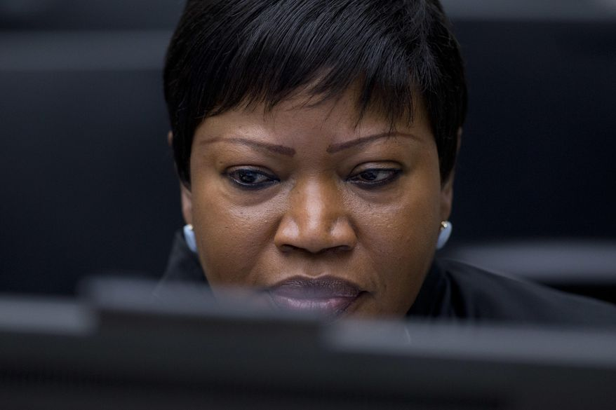 FILE - In this file photo dated Thursday, Jan. 28, 2016, Chief Prosecutor Fatou Bensouda waits for the start of the trial against former Ivory Coast president Laurent Gbagbo at the International Criminal Court in The Hague, Netherlands. The prosecutor of the International Criminal Court says she has had her U.S. visa revoked, in the first implementation of an American crackdown on the global tribunal. (AP Photo/Peter Dejong)