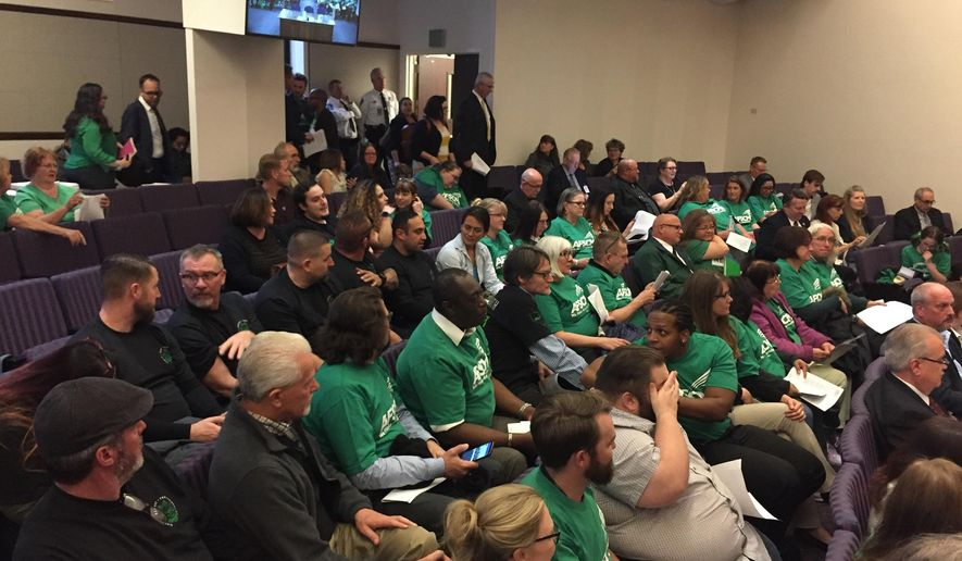 A crowd gathers before a hearing with Nevada lawmakers on a bill that would allow state workers to collectively bargain Thursday, April 4, 2019, in Carson City, Nev. The hearing drew dozens of people to the legislative building. The measure seeks to allow state workers the right to bargain collectively over wages, hours and other employment conditions. (AP Photo/Ryan Tarinelli)