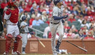 St. Louis Cardinals catcher Yadier Molina (4) and San Diego Padres' Fernando Tatis Jr. watch Tatis' two-run home run during the seventh inning of a baseball game Friday, April 5, 2019, in St. Louis. (AP Photo/Scott Kane)