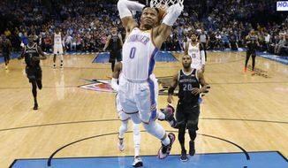 Oklahoma City Thunder guard Russell Westbrook (0) goes up for a dunk in front of Detroit Pistons guard Wayne Ellington (20) during the first half of an NBA basketball game Friday, April 5, 2019, in Oklahoma City. (AP Photo/Sue Ogrocki)
