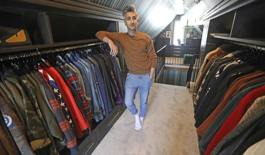 """In this March 15, 2019, photo, Tan France, a cast member on the Netflix series """"Queer Eye,"""" poses among his clothes in the attic of his home in Salt Lake City. The series touches on some of the country's deepest divides with persistent optimism. The makeover program starring five gay men tackles the contrast between urban and rural, white and black, liberal and conservative.  (AP Photo/Rick Bowmer)"""