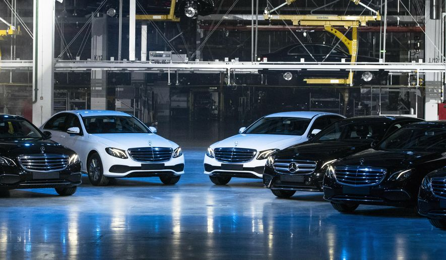 Cars are seen during an opening ceremony of the Mercedes Benz automobile assembly plant outside Moscow, Russia, Wednesday, April 3, 2019. Germany's Daimler AG has opened a new Mercedes factory in Russia, part of a 250 million euro ($281 million) investment it says will create 1,000 jobs. (AP Photo/Pavel Golovkin, Pool)