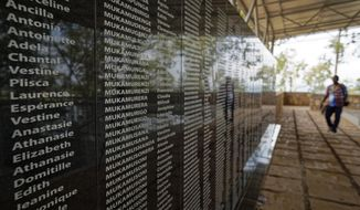 The names of those who were slaughtered as they sought refuge in the church, many with the same surname indicating a family, are written on a memorial to the thousands who were killed in and around the Catholic church during the 1994 genocide, outside the church in Ntarama, Rwanda Friday, April 5, 2019. Rwanda will commemorate on Sunday, April 7, 2019 the 25th anniversary of when the country descended into an orgy of violence in which some 800,000 Tutsis and moderate Hutus were massacred by the majority Hutu population over a 100-day period in what was the worst genocide in recent history. (AP Photo/Ben Curtis)