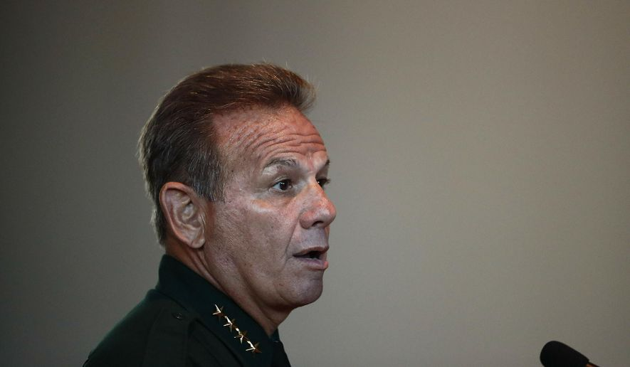 FILE - In this Nov. 15, 2018, file photo, Broward County Sheriff Scott Israel speaks before the state commission in Sunrise, Fla. A judge on Thursday, April 4. 2019, dismissed a lawsuit filed by Israel, whom Gov. Ron DeSantis suspended after accusing him of failing to prevent the Parkland school shooting. (AP Photo/Brynn Anderson, File)