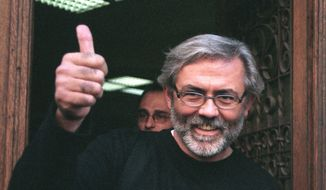 FILE  - This is undated file photo of Slavko Curuvija the owner and editor of two independent newspapers at the time, was gunned down on April 11, 1999, in Belgrade, Serbia. A Serbian court on Friday, April 5, 2019 has sentenced four former state security agents to up to 30 years in prison for the killing 20 years ago of a prominent journalist who was a fierce critic of then-strongman Slobodan Milosevic. (AP Photo/Pedja Milosavljevic, File)