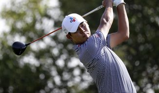 Si Woo Kim hits watches a shot on the 15th hole during the second round of the Valero Texas Open golf tournament Friday, April 5, 2019, in San Antonio. (AP Photo/Eric Gay)