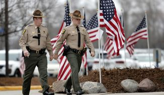 Visitation was held Thursday, April 4, 2019 in Grayslake, Ill. for Illinois State Trooper Gerald Ellis. Ellis died March 30 when Dan Davies, 44, of Calumet City, was driving in the wrong direction in the westbound lanes of I-94 and slammed into Ellis' squad car near Green Oaks, east of Libertyville, authorities said. Ellis, an Antioch resident, was 36. (Steve Lundy/Daily Herald via AP)