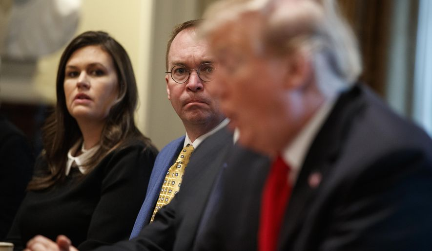Then-White House press secretary Sarah Sanders and acting White House Chief of Staff Mick Mulvaney listen as President Donald Trump speaks during a meeting with NATO Secretary-General Jens Stoltenberg in the Cabinet Room of the White House, Tuesday, April 2, 2019, in Washington. (AP Photo/Evan Vucci) ** FILE **