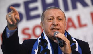 FILE-In this Tuesday, March 5, 2019 file photo Turkey's President Recep Tayyip Erdogan gestures as he delivers a speech at a rally of his ruling Justice and Development Party's (AKP) in Istanbul. The mood among opposition supporters in Turkey's biggest city is one of jubilation but also worry - fear that their win in Istanbul's mayoral race could be overturned in a recount taking place after the ruling party challenged the election results. (AP Photo/Lefteris Pitarakis, File)