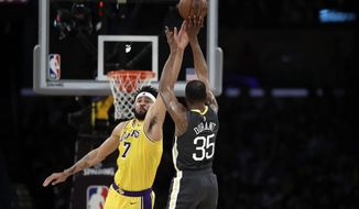 Golden State Warriors' Kevin Durant (35) shoots over Los Angeles Lakers' JaVale McGee during the first half of an NBA basketball game Thursday, April 4, 2019, in Los Angeles. (AP Photo/Marcio Jose Sanchez)