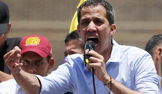 Opposition leader and self-proclaimed interim president Juan Guaido speaks to supporters during a rally to protest outages that left most of the country scrambling for days in the dark in Caracas, Venezuela, Saturday, April 6, 2019. Rival political factions are taking the streets across Venezuela in a mounting struggle for control of the crisis-wracked nation recently hit by crippling blackouts. (AP Photo/Fernando Llano)