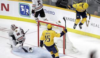 Nashville Predators left wing Viktor Arvidsson (33), of Sweden, celebrates after scoring a goal against Chicago Blackhawks goaltender Cam Ward (30) during the third period of an NHL hockey game Saturday, April 6, 2019, in Nashville, Tenn. (AP Photo/Mark Humphrey)