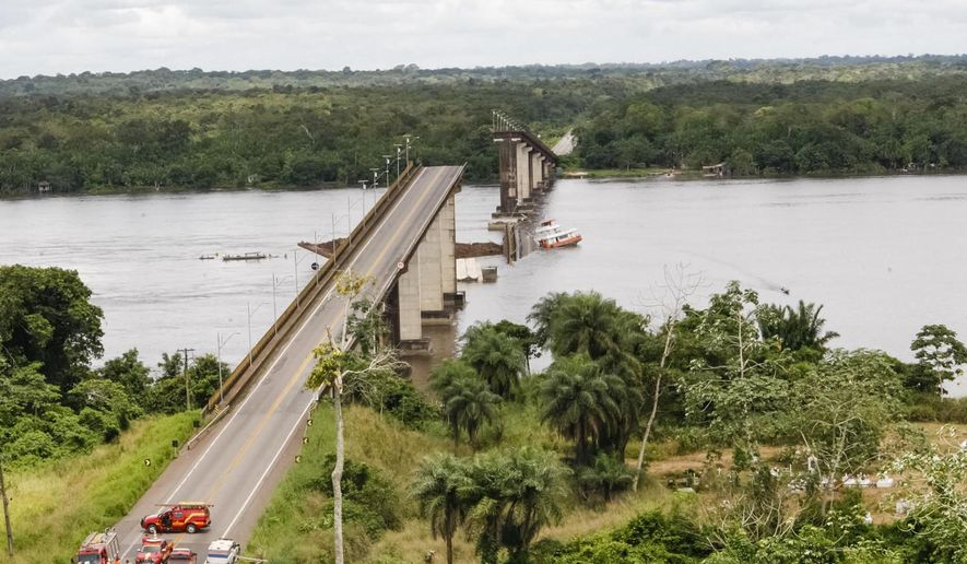 In this April 6, 2019 handout photo released by Para Government, a ferry boat collided with a bridge pillar causing part of the bridge to collapse in the Moju river, state of Para, Brazil. Para state Gov. Helder Barbalho tells reporters that witnesses reported two small cars fell into the water due to Saturday's accident, which occurred on a highway leading to the port city of Belem, the state capital. Scuba divers are searching for survivors. It's not clear how many people were in the cars. (Fernando Araujo/Para Government via AP)