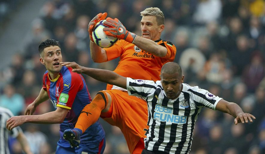Crystal Palace goalkeeper Vicente Guaita makes a save during the English Premier League soccer match against Newcastle United at St James' Park, Newcastle, England, Saturday April 6, 2019. (Owen Humphreys/PA via AP)