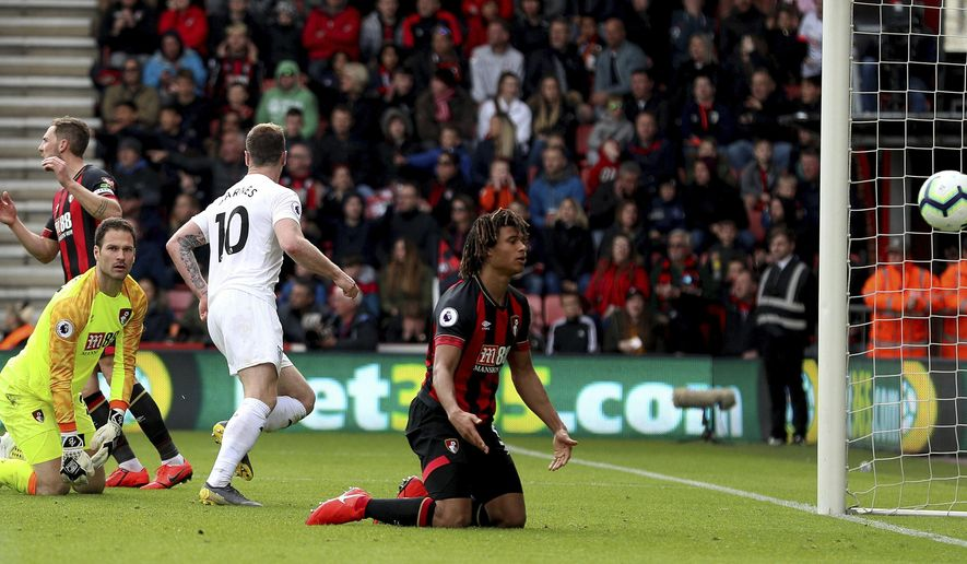 Burnley's Ashley Barnes, center, scores against Bournemouth during the English Premier League soccer match against Bournemouth at the Vitality Stadium, Bournemouth, England, Saturday April 6, 2019. (Andrew Matthews/PA via AP)