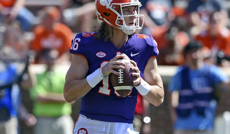 Clemson's Trevor Lawrence drops back to pass during Clemson's annual Orange and White NCAA college football spring scrimmage Saturday, April 6, 2019, in Clemson, S.C. (AP Photo/Richard Shiro)