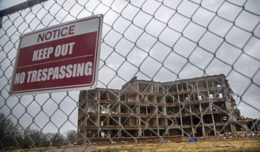 St. Joseph's Hospital in Ottumwa sits half demolished Wednesday, March 13, 2019. The building has been left half torn down for months. ( Zachary Boyden-Holmes/The Des Moines Register via AP)