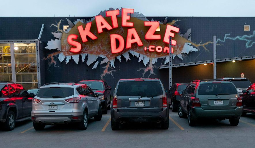 Cars fill the lot on the final Adult Request Skate at SkateDaze, 3616 S. 132nd Street in Omaha. The rink closed on March 31, 2019. (Kent Sievers/Omaha World-Herald via AP)