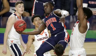 Auburn's Jared Harper (1) takes a shot during the second half in the semifinals of the Final Four NCAA college basketball tournament against the Virginia, Saturday, April 6, 2019, in Minneapolis. (AP Photo/Matt York)