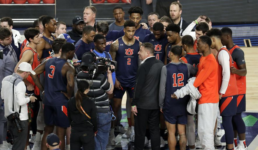 Auburn head coach Bruce Pearl talks to his team during a practice session for the semifinals of the Final Four NCAA college basketball tournament, Friday, April 5, 2019, in Minneapolis. (AP Photo/Matt York)