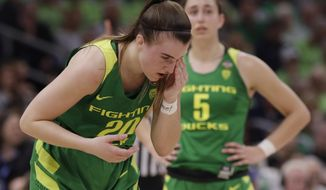 Oregon guard Sabrina Ionescu (20) wipes her eye during the second half of a women's Final Four NCAA college basketball semifinal tournament game against the Baylor, Friday, April 5, 2019, in Tampa, Fla. (AP Photo/Chris O'Meara)