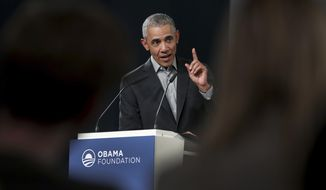 Former US President Barack Obama gestures as he speaks during a town hall meeting at the 'European School For Management And Technology' (ESMT) in Berlin, Germany, Saturday, April 6, 2019. (AP Photo/Michael Sohn)