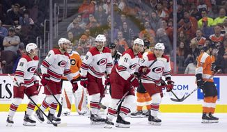 Carolina Hurricanes' Jordan Staal (11) celebrates his goal with teammates during the second period of an NHL hockey game against the Philadelphia Flyers, Saturday, April 6, 2019, in Philadelphia. (AP Photo/Chris Szagola)