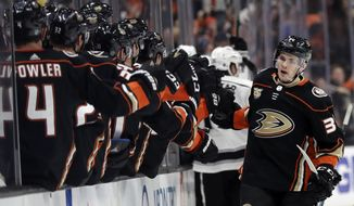 Anaheim Ducks' Sam Steel, right, celebrates his goal with teammates during the third period of an NHL hockey game against the Los Angeles Kings on Friday, April 5, 2019, in Anaheim, Calif. (AP Photo/Marcio Jose Sanchez)