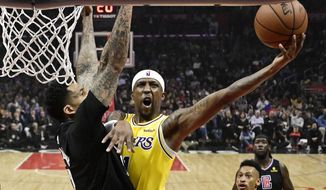Los Angeles Lakers guard Kentavious Caldwell-Pope shoots as Los Angeles Clippers forward Wilson Chandler defends during the first half of an NBA basketball game Friday, April 5, 2019, in Los Angeles. (AP Photo/Mark J. Terrill)