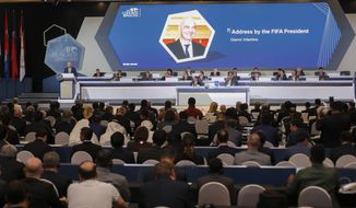 FIFA President Gianni Infantino, left, on stage speaks during the 29th AFC Congress in Kuala Lumpur, Malaysia, Saturday, April 6, 2019. The Asian Football Confederation holds its presidential election on Saturday. (AP Photo/Vincent Thian)