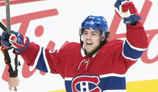 Montreal Canadiens' Ryan Poehling celebrates after scoring against the Toronto Maple Leafs during first period NHL hockey action in Montreal, Saturday, April 6, 2019. (Graham Hughes/The Canadian Press via AP)