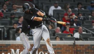 Miami Marlins' Jorge Alfaro hits a two-run home run during the ninth inning of the team's baseball game against the Atlanta Braves, Saturday, April 6, 2019, in Atlanta. (AP Photo/John Amis)