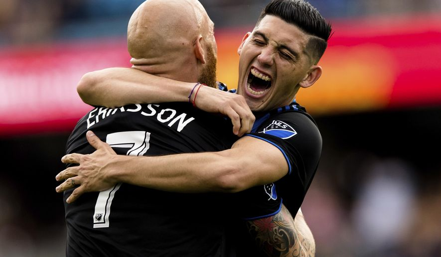 San Jose Earthquakes midfielder Magnus Eriksson, left, and forward Cristian Espinoza (10) celebrate after a goal against the Portland Timbers in the first half of an MLS soccer match on Saturday, April 6, 2019 in San Jose, Calif. (AP Photo/John Hefti)