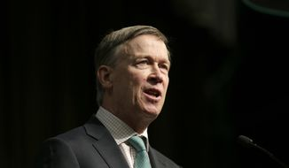 Former Colorado Gov. John Hickenlooper, a candidate for the 2020 Democratic presidential nomination, addresses the National Action Network Convention in New York, Friday, April 5, 2019. (AP Photo/Seth Wenig) ** FILE **