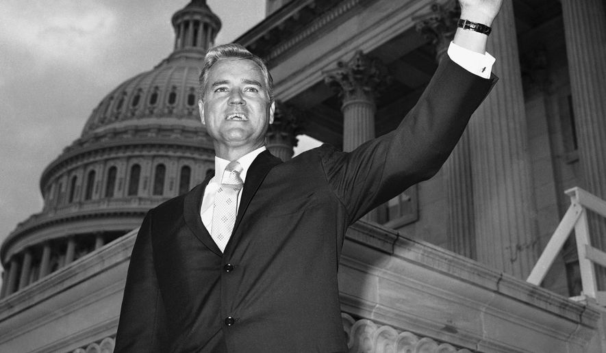FILE - In this Nov. 10, 1966 file photo, Senator-elect Ernest Hollings, D-S.C., poses in front of the Capitol in Washington. Hollings, a moderate six-term Democrat who made an unsuccessful bid for the presidency in 1984, has died. He was 97. Family spokesman Andy Brack says Hollings died early Saturday, April 6, 2019. (AP Photo/Henry Griffin, File)