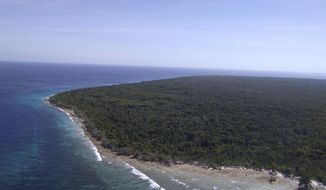This undated photo provided by Western Mindanao Command (WESMINCOM) Armed Forces of the Philippines Saturday, April 6, 2019, shows the island where an Indonesian hostage held by Muslim militants was rescued by Philippine troops on Friday, April 5 in Sulu province in southern Philippines. Officials said Saturday, an Indonesian hostage swam his way to freedom but another drowned while a Malaysian was shot in the back while escaping. (WESMINCOM Armed Forces of the Philippines via AP)