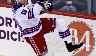 New York Rangers' Ryan Strome celebrates his winning goal in the overtime period of an NHL hockey game against the Pittsburgh Penguins in Pittsburgh, Saturday, April 6, 2019. (AP Photo/Gene J. Puskar)