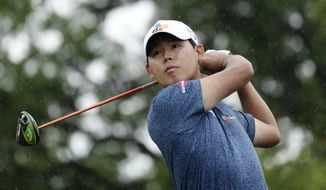Si Woo Kim watches his drive on the second hole during the third round of the Texas Open golf tournament, Saturday, April 6, 2019, in San Antonio. (AP Photo/Eric Gay)