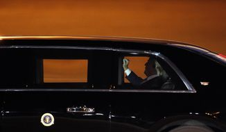 President Donald Trump leaves in the presidential limousine after arriving at McCarran International Airport, Friday, April 5, 2019, in Las Vegas. Trump is scheduled to speak at the Republican Jewish Coalition National Leadership Meeting in Las Vegas Saturday. (AP Photo/John Locher)