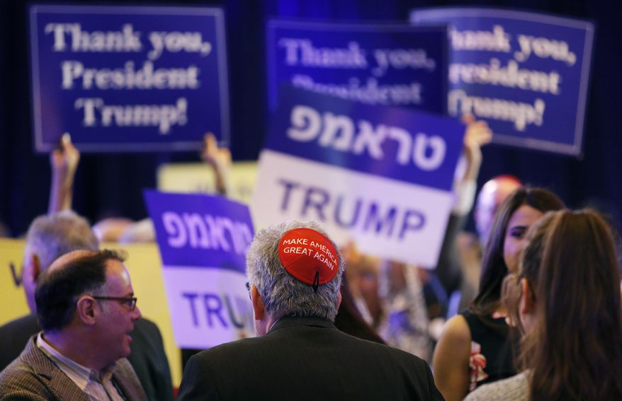 """An attendee wears a """"Make America Great Again"""" yarmulke before President Donald Trump speaks at an annual meeting of the Republican Jewish Coalition, Saturday, April 6, 2019, in Las Vegas. (AP Photo/John Locher)"""