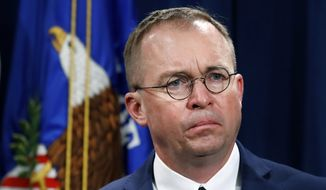 "In this July 11, 2018, file photo, Mick Mulvaney, acting director of the Consumer Financial Protection Bureau (CFPB), and director of the Office of Management, listens during a news conference at the Department of Justice in Washington. White House acting Chief of Staff Mulvaney said in an interview with ""Fox News Sunday"" Democrats will ""never"" see President Donald Trump's tax returns. (AP Photo/Jacquelyn Martin, File)"