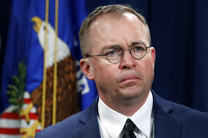 """In this July 11, 2018, file photo, Mick Mulvaney, acting director of the Consumer Financial Protection Bureau (CFPB), and director of the Office of Management, listens during a news conference at the Department of Justice in Washington. White House acting Chief of Staff Mulvaney said in an interview with """"Fox News Sunday"""" Democrats will """"never"""" see President Donald Trump's tax returns. (AP Photo/Jacquelyn Martin, File)"""