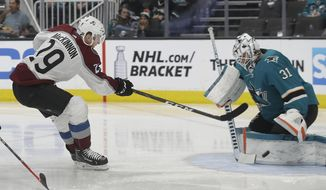 Colorado Avalanche center Nathan MacKinnon (29) shoots against San Jose Sharks goaltender Martin Jones (31) and scores, during the second period of an NHL hockey game in San Jose, Calif., Saturday, April 6, 2019. (AP Photo/Jeff Chiu)