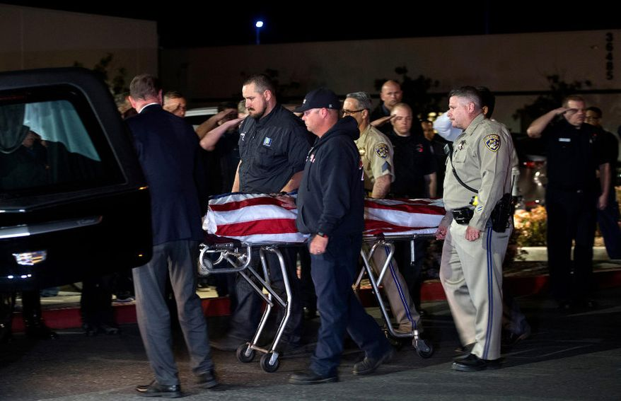 In this Saturday, April 6, 2019 photo, officers escort the remains of fallen California Highway Patrol Sgt. Steve Licon's as it is transferred from the Inland Valley Medical Center to the Perris Coroner in Wildomar, Calif. Motorcycle officer Sgt. Licon was involved in a collision on the I-15 Freeway in Lake Elsinore Saturday afternoon. Michael Callahan of Winchester was booked on the charges in the death of California Highway Patrol Sgt. Steve Licon, said Officer Steve Carapia. (Cindy Yamanaka/The Orange County Register via AP)