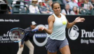 Madison Keys returns a shot to Monica Puig, from Puerto Rico, during their semifinal at the Volvo Car Open in Charleston, S.C., Saturday, April 6, 2019. (AP Photo/Mic Smith)