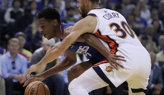 Los Angeles Clippers' Shai Gilgeous-Alexander, left, is defended by Golden State Warriors' Stephen Curry (30) during the first half of an NBA basketball game Sunday, April 7, 2019, in Oakland, Calif. (AP Photo/Ben Margot)