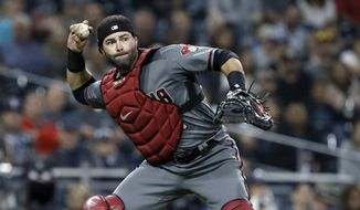 Arizona Diamondbacks catcher Alex Avila throws out San Diego Padres' Wil Myers on a ground out during the first inning of a baseball game in San Diego, Monday, April 1, 2019. (AP Photo/Alex Gallardo) **FILE**
