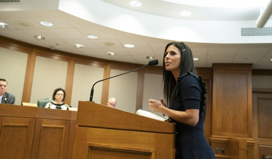 In this Wednesday, April 3, 2019 photo, Ashley Spence, of Austin testifies before the House Homeland Security and Public Safety Committee in Austin, Texas, in favor of HB 1399, a bill sponsored by state Rep. Reggie Smith, R-Van Alstyne, that would require DNA collection from most people accused in felony cases. Texas lawmakers are considering whether to expand DNA laws and allow samples to be taken from more defendants in criminal investigations. (Bob Daemmrich/Austin American-Statesman via AP)